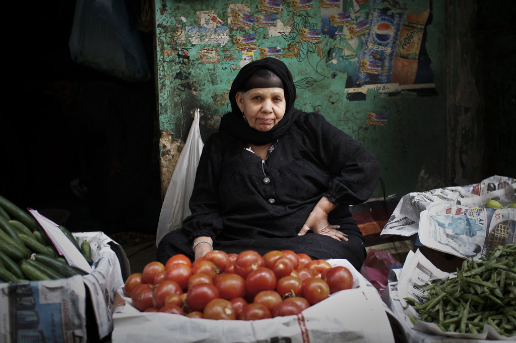 Om Badria  makes a living from selling vegetables in streets, To raise her daughters after her husband's death.